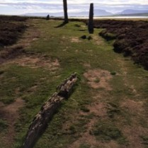 The Ring of Brodgar with the notch in the hills on Hoy in the background