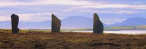 Ring of Brodgar with Ward Hill in the bckground