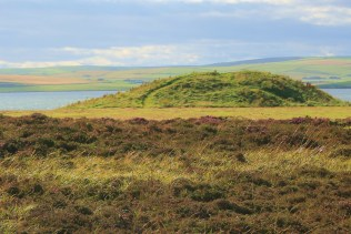 The Salt Knowe from the edge of the Ring of Brodgar with the Loch of Stenness beyond